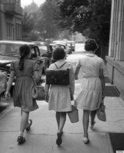 1959: Three young friends walking down a street in Baden-Baden, a spa town in the Black Forest, south-west Germany. (Photo by Erich Auerbach/Getty Images)